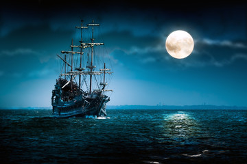 Fototapeta Old pirate ship Flying Dutchman sailing to the moon