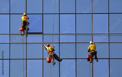 Men washing windows at height Canvas Print