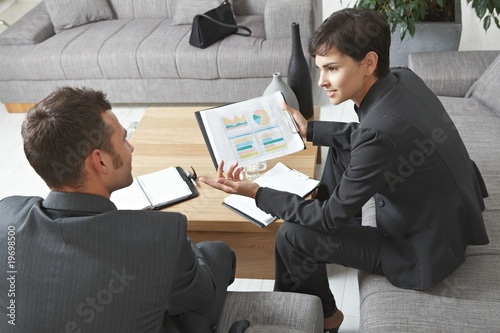 Businesspeople discussing charts Canvas Print