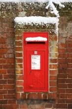 A British Letter Box In The Winter Snow