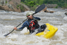 Kayaker Fighting The Rapids Of...