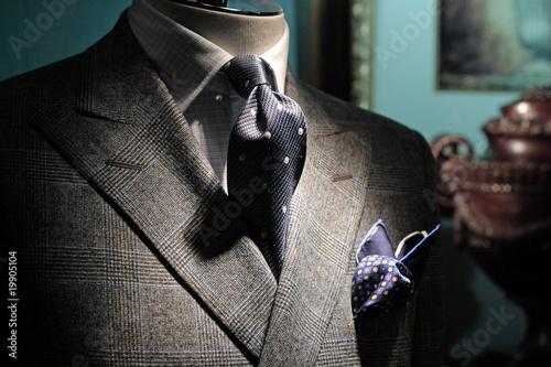 Obraz Grey checkered jacket, dark blue tie and handkerchief (vertical) - fototapety do salonu