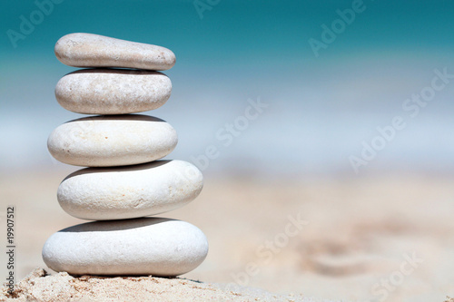Acrylic Prints Stones in Sand Stack of stones arrenged as tower on the beach