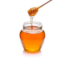 Jar Of Honey With Wooden Drizzler Isolated On White