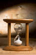 Hourglass on a wooden background