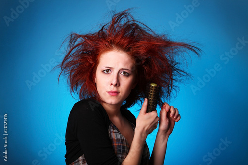 Fotografie, Obraz  Girl with hair raiser in panic try to combing own hair