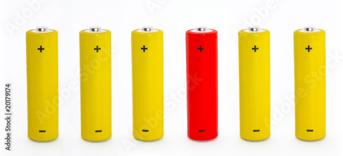 Photo  Row of batteries with one outstanding