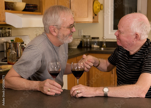 Fotografie, Obraz  Mature married gay couple having wine and showing affection