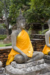 Stone statue of a Buddha in Ayutthaya, Thailand.
