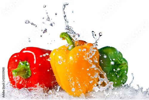 Fototapeta red, yellow and green pepper with water splash isolated on white