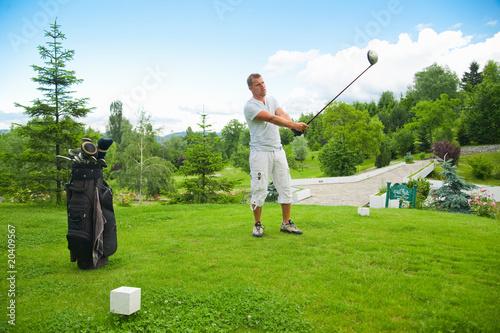 Deurstickers Golf Young man golfing