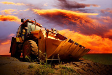 Yellow Tractor On Golden Suris...