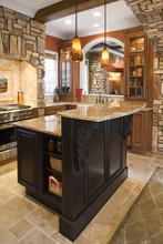 Kitchen Interior With Stone Accents In Affluent Home