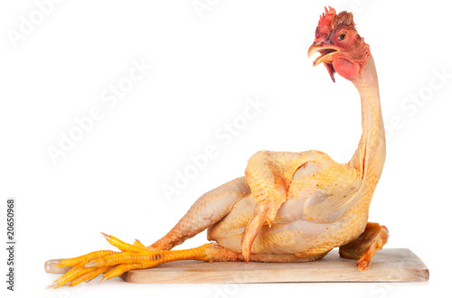 Leinwand Poster raw chicken on cutting board isolated