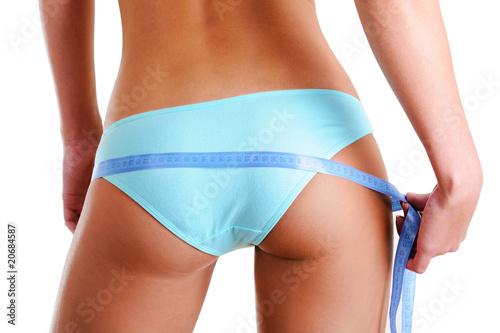 Fotografie, Obraz  Female buttocks with a measurement tape