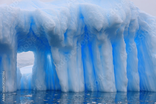 Iceberg with window in Antarctica
