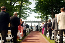 Guests Line The Aisle At A Wedding Ceremony