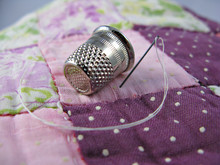 Silver Colored Thimble On An O...