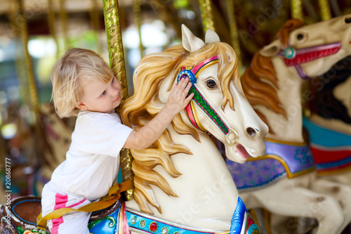 Poster Attraction parc child on the horse