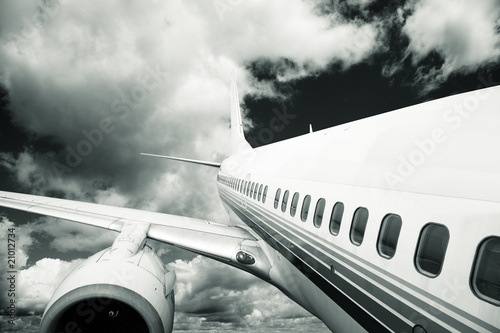 the airplane with the blue sky background. - 21012734