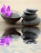décor relaxant, basaltes, noix de coco, orchidée, fond bambou