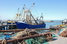 Nets And Fishing Boat In A Dutch Harbor In  Nature Reserve