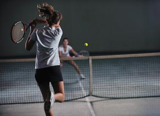 Fototapeta young girls playing tennis game indoor