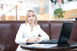Young businesswoman with notebook in cafe