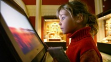 Little Girl Looks At Interactive Display In Museum