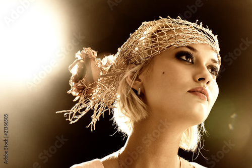 Sepia toned portrait of beautiful retro-style woman in bonnet Canvas Print