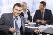 Smiling businessman at meeting
