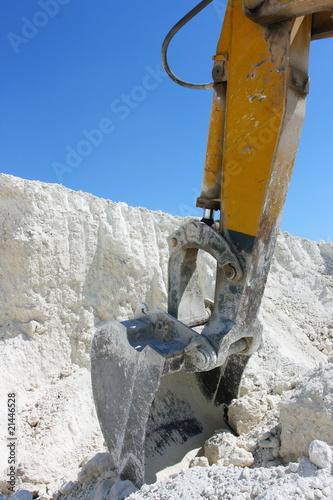 Caterpillar excavator jib in chalk pit against a blue sky #21446528