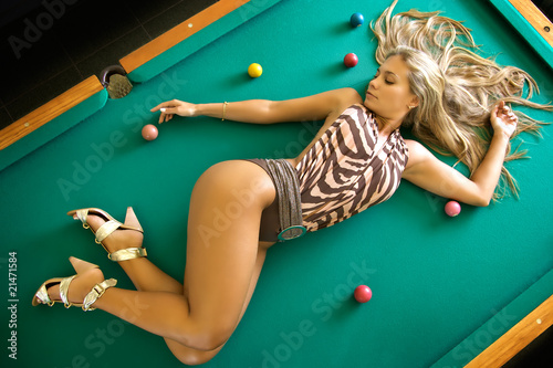 Fotografie, Tablou  sex blonde model in swimwear laying on a pool table
