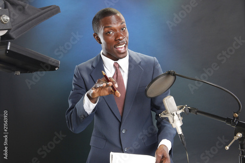 Photo TV/Radio news anchor with prompter and microphone