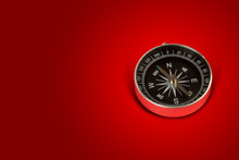Magnetic Compass In Red Background