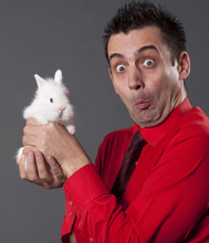 Funny Young Man Holding Baby Rabbit