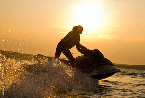 beautiful girl riding her jet skis