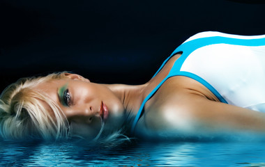 Sexy blonde in blue water