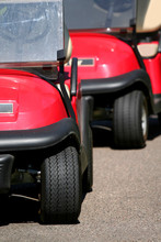 Red Golf Carts Close Up Shot In A Row