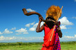 Leinwanddruck Bild - Masai warrior playing traditional horn