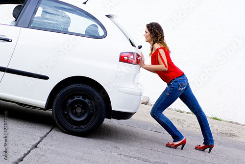 woman pushing car out of gasoline buy this stock photo and explore