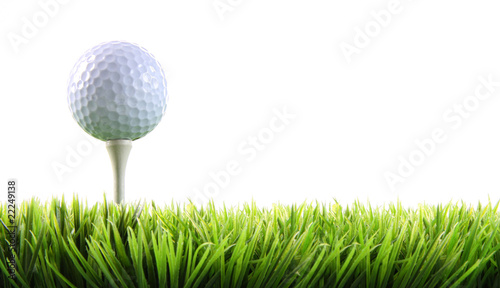 Golf ball with tee in the grass Fototapet