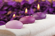 purple candles on massage towel (1)