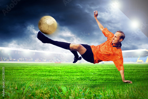 Foto op Plexiglas Voetbal Happiness football player after goal on the field of stadium wit
