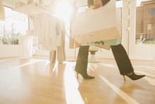 Multi-ethnic Women Holding Shopping Bags In Shop