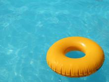 Yellow Lifebuoy In Pool
