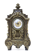 An Antique Clock Ornate With F...