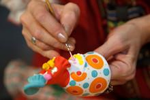 Painting Pottery Figurines. Ru...