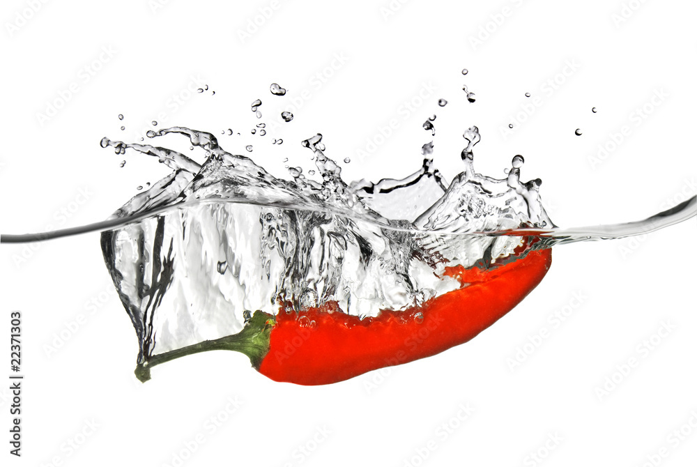 Photo  red pepper dropped into water with splash isolated on white