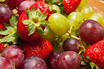 Fresh strawberries and grapes
